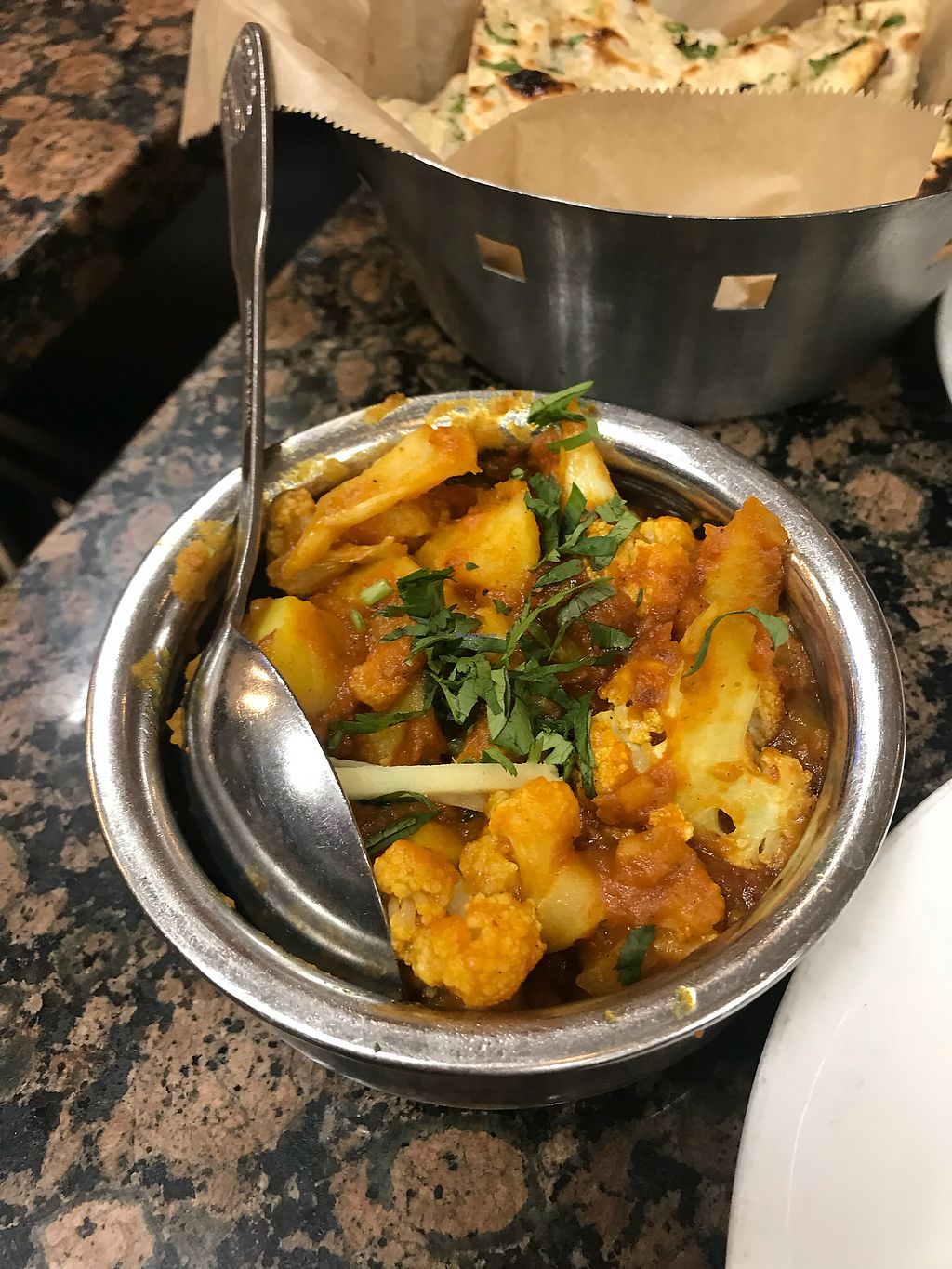 "Photo of Bhanu's Indian Grocery and Cuisine  by <a href=""/members/profile/Vegan_Ness"">Vegan_Ness</a> <br/>Aloo Gobi (potatoes/cauliflower)  <br/> January 2, 2018  - <a href='/contact/abuse/image/39050/342271'>Report</a>"