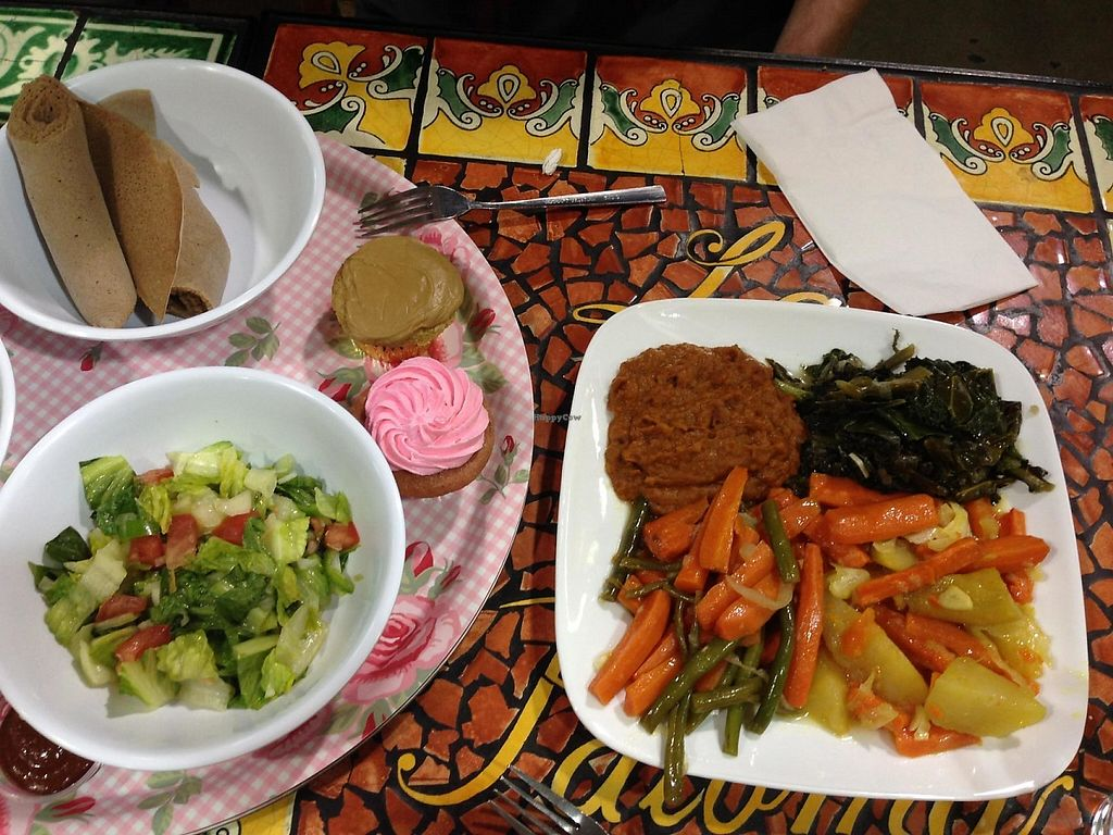 "Photo of Azla Vegan  by <a href=""/members/profile/NomNomNominator"">NomNomNominator</a> <br/>Main plate has: Gomen dish, Yatkilt dish, Fasolia dish, & a Greenbean dish