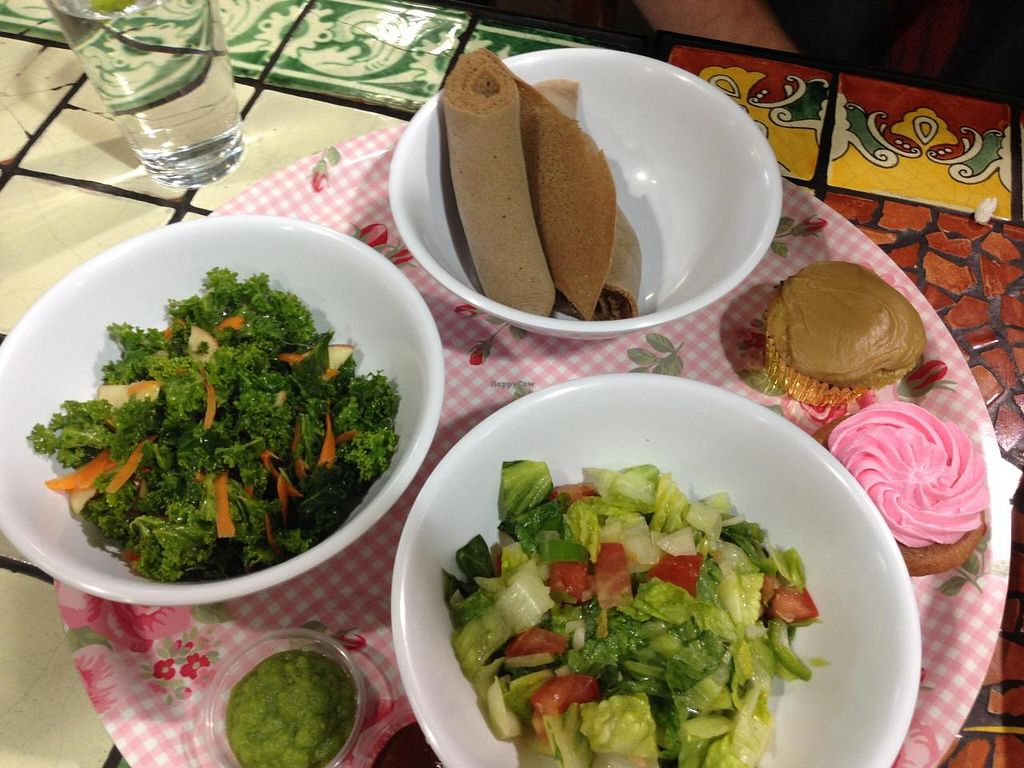 "Photo of Azla Vegan  by <a href=""/members/profile/NomNomNominator"">NomNomNominator</a> <br/>Side plate has: Strawberry cupcake (gf), Carmel cupcake (gf), Timatam salad, Shimbra salad & gf injera <br/> April 30, 2014  - <a href='/contact/abuse/image/39479/69014'>Report</a>"