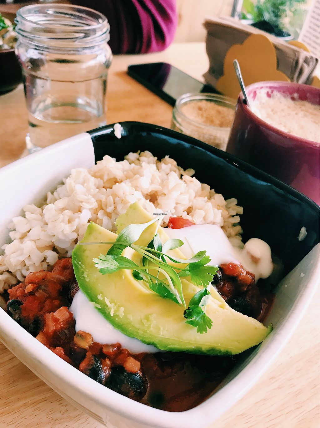 """Photo of Mad Cucumber - Vegan Lounge  by <a href=""""/members/profile/CristinaBrull"""">CristinaBrull</a> <br/>Five Bean Chili with Rice and Soya Latte <br/> August 1, 2017  - <a href='/contact/abuse/image/39613/287777'>Report</a>"""
