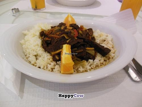 "Photo of Cafe A Brasileira  by <a href=""/members/profile/yessija"">yessija</a> <br/>Seitan meat with orange sauce and rice <br/> August 11, 2013  - <a href='/contact/abuse/image/39834/53087'>Report</a>"