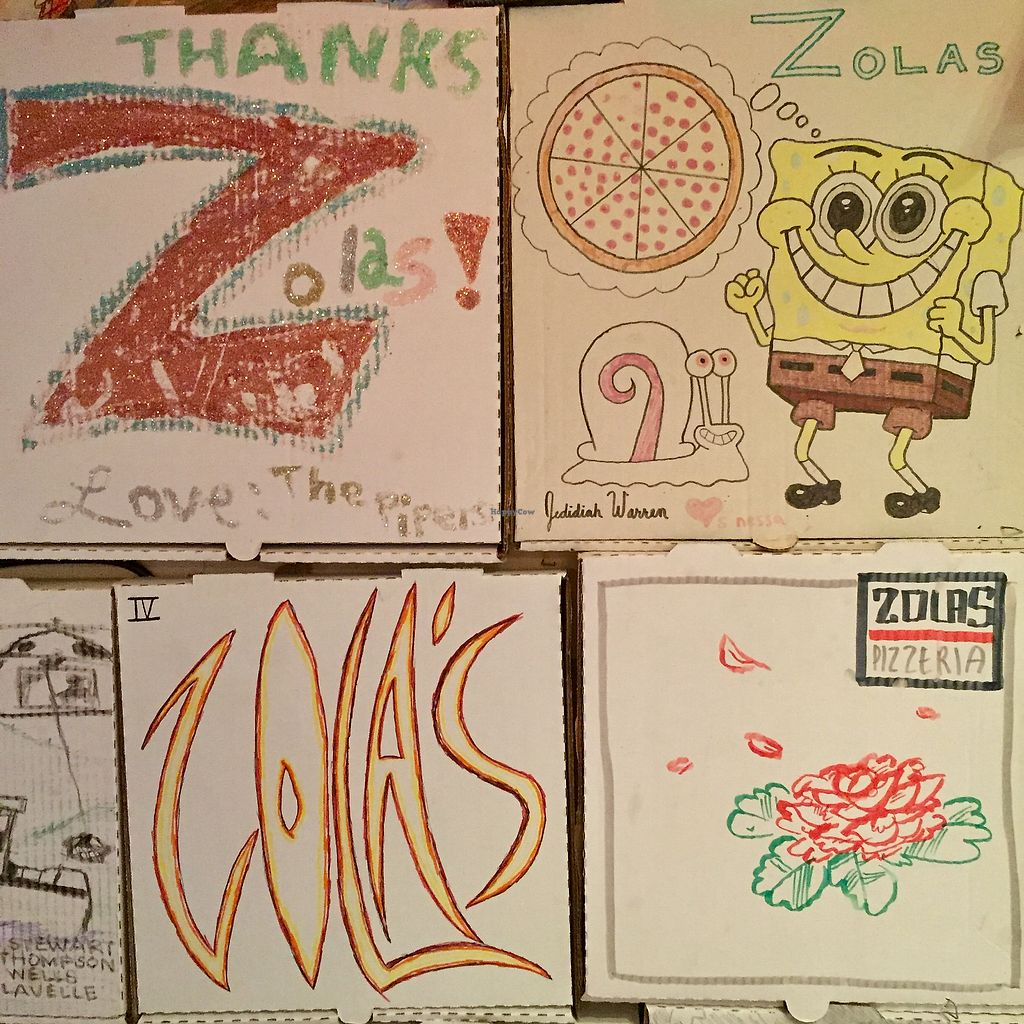 """Photo of Zola's Pizzeria  by <a href=""""/members/profile/happycowgirl"""">happycowgirl</a> <br/>painted pizza boxes on the walls : ) <br/> December 29, 2017  - <a href='/contact/abuse/image/39893/340300'>Report</a>"""