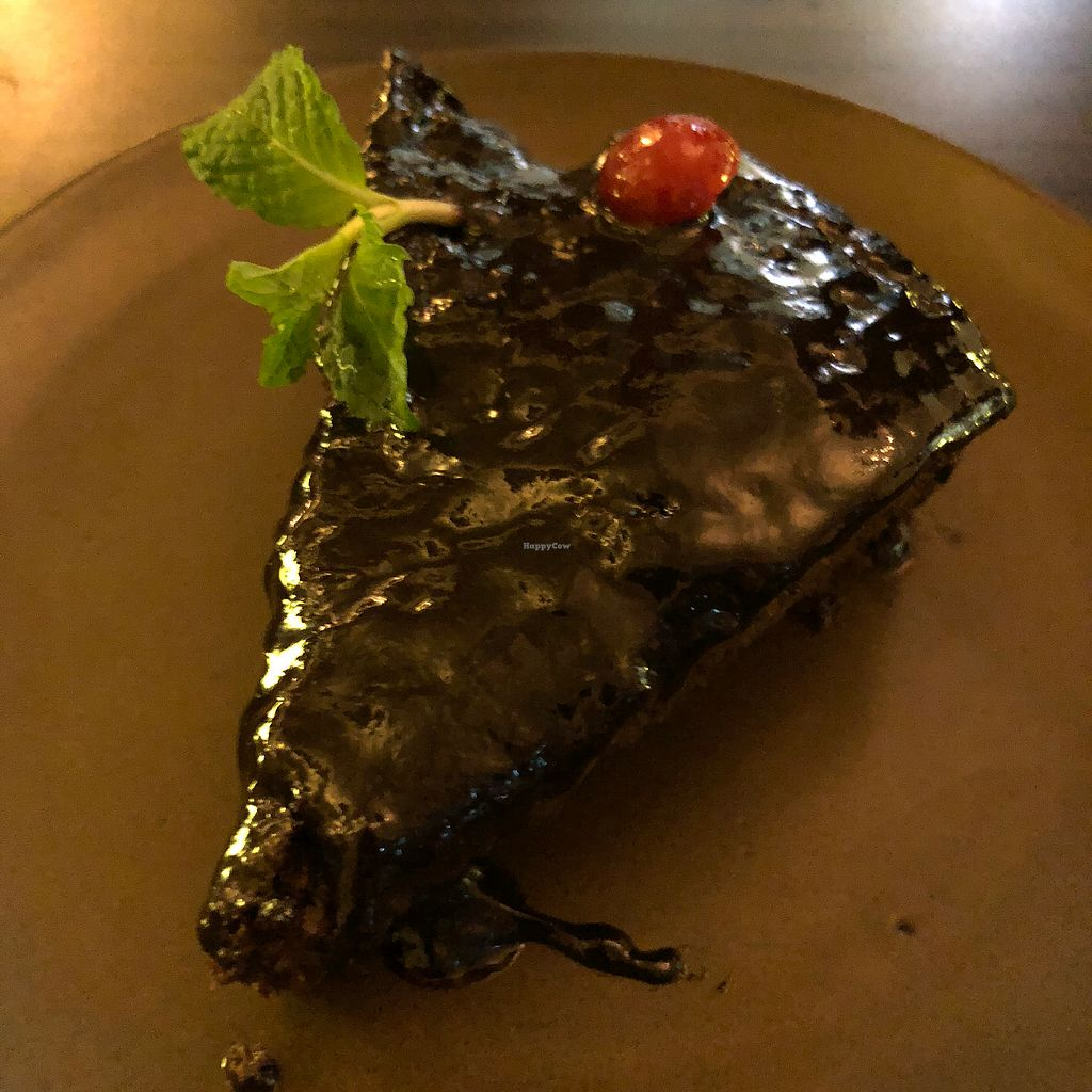 """Photo of Places Restaurant and Bar  by <a href=""""/members/profile/earthville"""">earthville</a> <br/>Vegan chocolate cake <br/> March 12, 2018  - <a href='/contact/abuse/image/40015/369521'>Report</a>"""