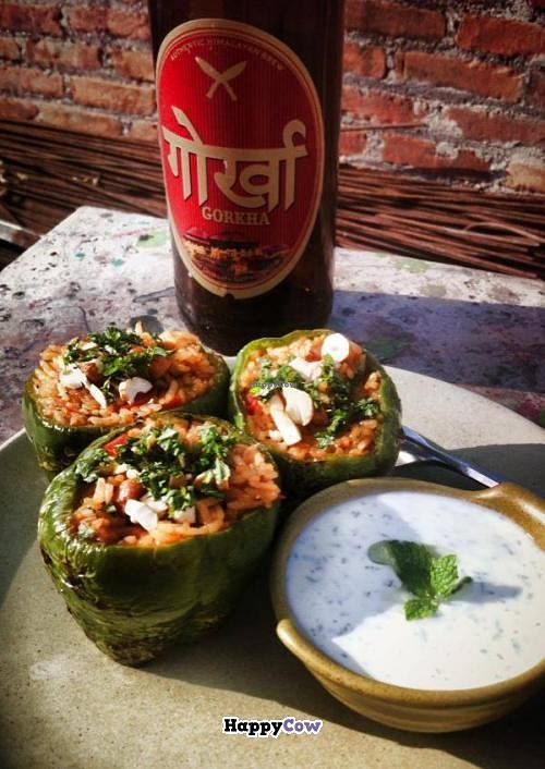 """Photo of Places Restaurant and Bar  by <a href=""""/members/profile/mblarsen"""">mblarsen</a> <br/>Turkish Biber Dolmasi with a cold Gorkha beer in the sun <br/> October 1, 2013  - <a href='/contact/abuse/image/40015/56127'>Report</a>"""