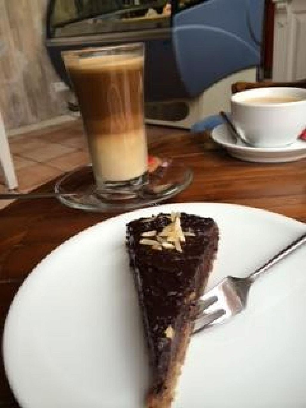 """Photo of Liberty Eiscafe and Bistro - Am Fischmarkt  by <a href=""""/members/profile/Plantpower"""">Plantpower</a> <br/>Raw cake and oat milk latte <br/> October 31, 2014  - <a href='/contact/abuse/image/40091/84271'>Report</a>"""