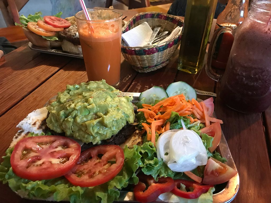 """Photo of Brunch de Salento  by <a href=""""/members/profile/Pearlpeachy"""">Pearlpeachy</a> <br/>Guacamole black bean burger on an arepa with a side salad <br/> November 23, 2017  - <a href='/contact/abuse/image/40127/328248'>Report</a>"""