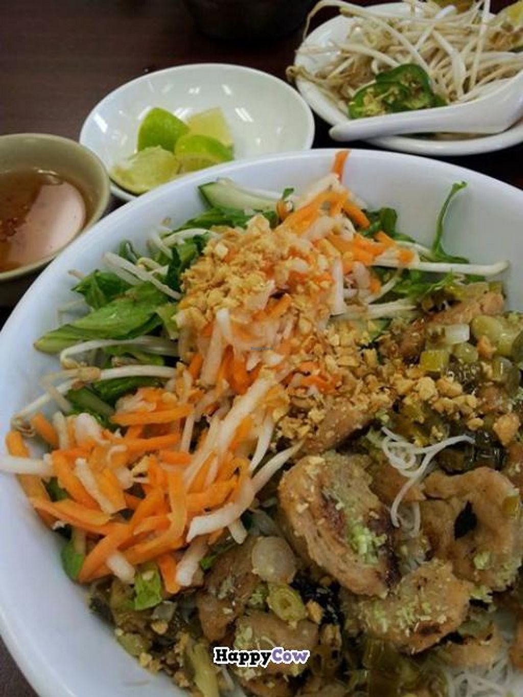 """Photo of CLOSED: Saigon Flavors  by <a href=""""/members/profile/Vegan%20Captioner"""">Vegan Captioner</a> <br/>One of the many vegan options here.  It's the rice noodle bowl with vegan chick'n.  It comes with a spicy sauce on the side, and they also offer peanut sauce or soy sauce if preferred.  This is so delicious and abundant!   <br/> July 25, 2013  - <a href='/contact/abuse/image/40183/52182'>Report</a>"""