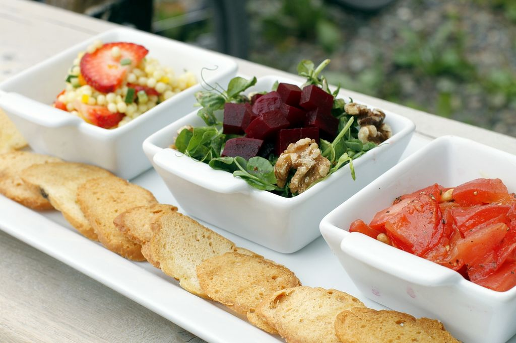 """Photo of Eddyline Bistro Cafe  by <a href=""""/members/profile/vegancookbookaddict"""">vegancookbookaddict</a> <br/>Three salads: Israeli couscous with strawberries, beets with greens and walnuts, and tomatoes with pinenuts.  Served with toasted baguette drizzled in olive oil <br/> August 30, 2015  - <a href='/contact/abuse/image/40281/115845'>Report</a>"""