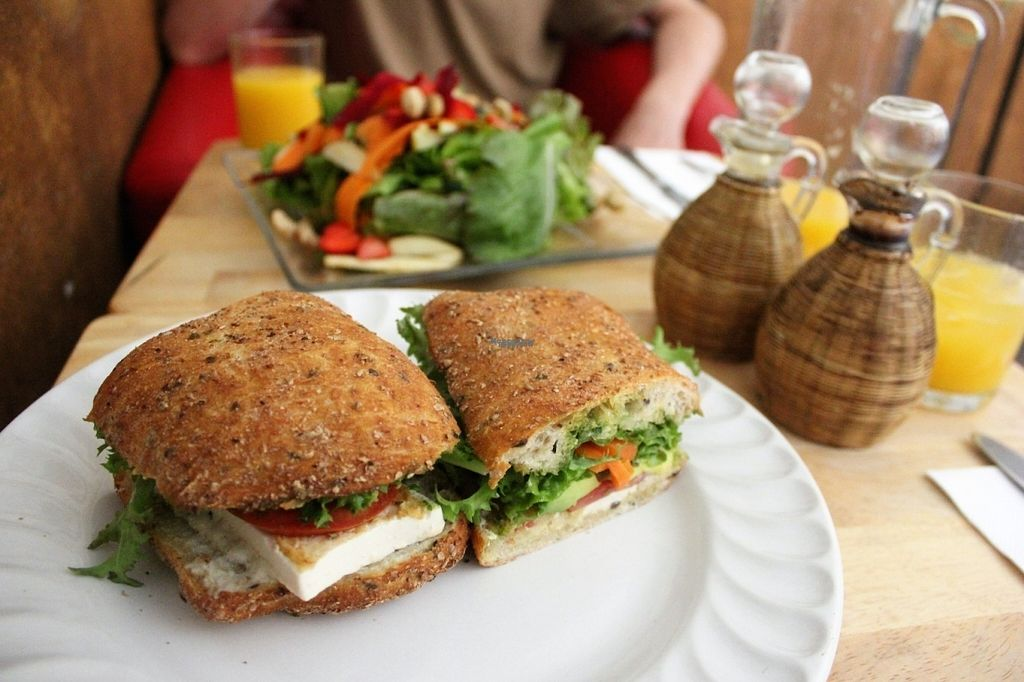 """Photo of Xiguela Cafe Food and Grocery  by <a href=""""/members/profile/charlieontravel"""">charlieontravel</a> <br/>Wholegrain ciabatta with tofu, pesto and salad. In the background is vegan salad with cashews, beets and strawberries <br/> October 28, 2016  - <a href='/contact/abuse/image/40333/185004'>Report</a>"""