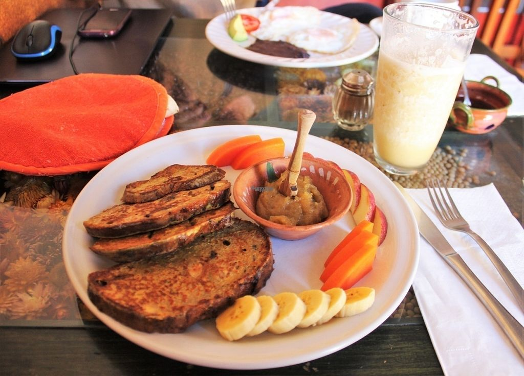 """Photo of Xiguela Cafe Food and Grocery  by <a href=""""/members/profile/charlieontravel"""">charlieontravel</a> <br/>French toast with apple jam and fruit. Banana smoothie blended with water/ice in the background <br/> October 28, 2016  - <a href='/contact/abuse/image/40333/185005'>Report</a>"""
