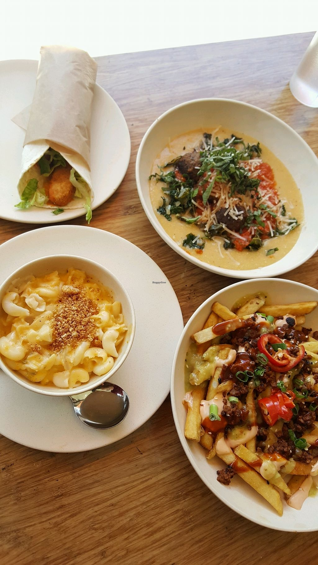 """Photo of Veggie Grill  by <a href=""""/members/profile/kwhalon"""">kwhalon</a> <br/>Buffalo chicken wrap, Mac n cheese, Meatball + polenta bowl, Kung fu fries <br/> April 16, 2018  - <a href='/contact/abuse/image/40894/386616'>Report</a>"""