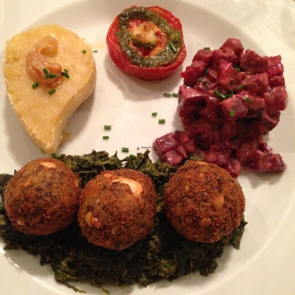 """Photo of Le Potager du Marais  by <a href=""""/members/profile/vegankt"""">vegankt</a> <br/>pink lentil balls on a bed of spinach, smashed potatoes, roasted tomato with pesto, and beetroot salad  <br/> October 28, 2014  - <a href='/contact/abuse/image/4106/84137'>Report</a>"""