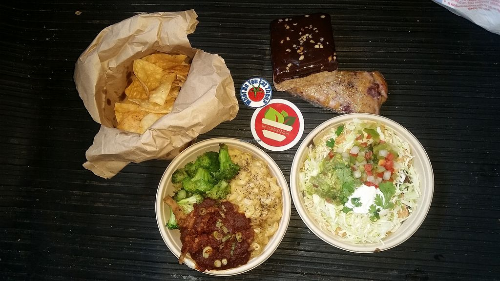 """Photo of The Loaded Bowl  by <a href=""""/members/profile/WhatDoYouEatThen"""">WhatDoYouEatThen</a> <br/>The Loaded Bowl We visited this Vegan Restaurant for the first time onOct 3, 2017 Bought Lunch & Dinner at the Loaded Bowl in Oklahoma City, OK  Cashew Cheese & Macaroni with fake-meat BBQ And veggie nachos The nachos were very good, ill order those again (and we will be back in OKC)  More pictures http://whatdoyoueatthen.com/the-loaded-bowl-oklahoma-city-ok/  The other, well i should have read the menu better, i saw cashew nut cheese & macaroni and not the BBQ part... i hate BBQ and i dont like fake-meat at all, any flavor, so there was no way i was gonna like half this meal I ate it, and this was prob made well. But, just not my taste  The deserts... got a huge rice crispy thing with chocolate on top, took three days to eat  Well, they had a few day old things marked down, so that always catches my attention. .. i grabbed a strawberry & black pepper (yes black pepper) scone. .. it was awesome !!! Try new things, this was great, dry, sweet scone, with strawberry flavor and a warm black pepper after flavor, wow.. i would have never known that could be a thing, very good, try it  Glad to have a vegan option when we are in town for the museum or passing through to Tulsa #OklahomaVegan #OklahomaCityVegan #CashewNutCheese #WhatDoYouEatThen <br/> December 18, 2017  - <a href='/contact/abuse/image/41128/336759'>Report</a>"""