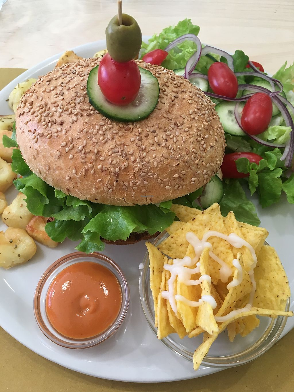 "Photo of Universo Vegano  by <a href=""/members/profile/hokusai77"">hokusai77</a> <br/>Bean burger, salad, rosemary baked potatoes, nachos and jalapeño sauce <br/> November 30, 2017  - <a href='/contact/abuse/image/41571/330877'>Report</a>"