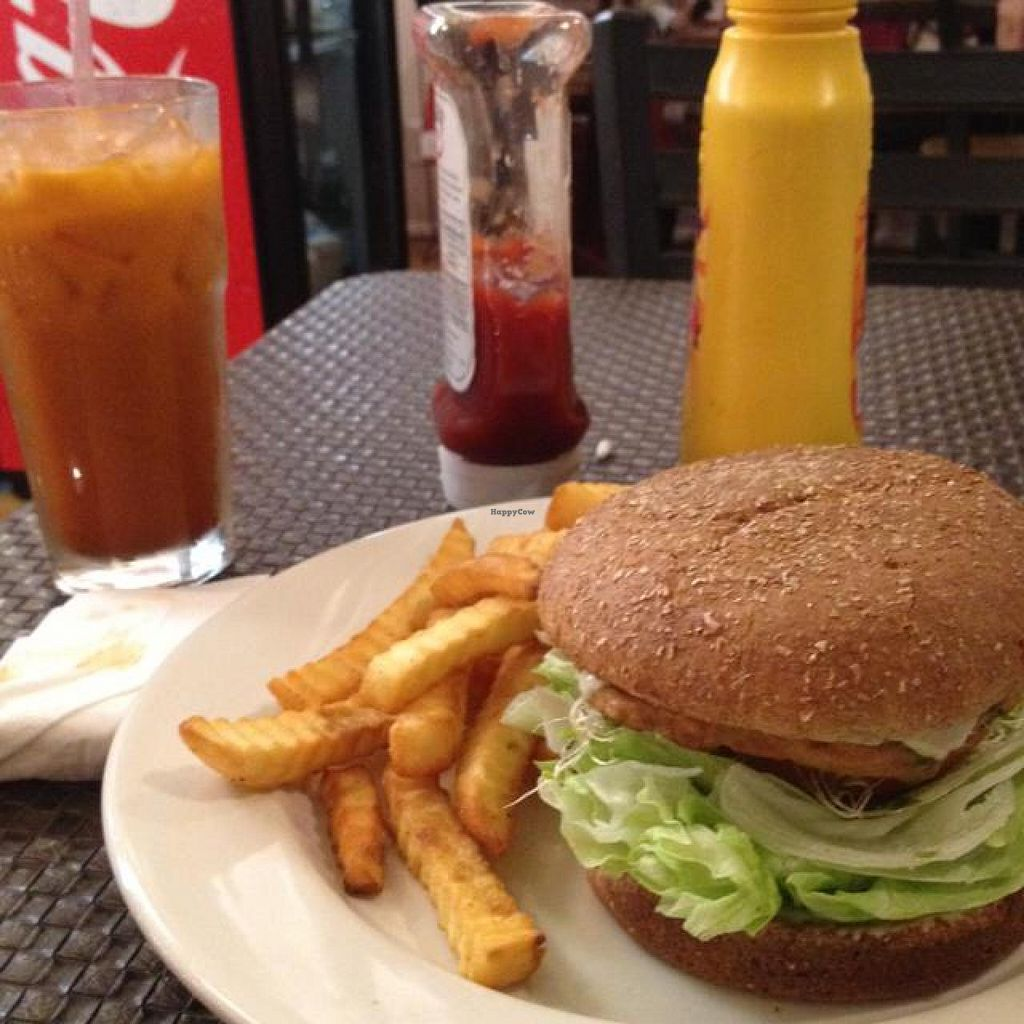 """Photo of Veggie House  by <a href=""""/members/profile/ACBuhay"""">ACBuhay</a> <br/>the Cowboy burger with a Thai tea <br/> December 2, 2014  - <a href='/contact/abuse/image/41594/87099'>Report</a>"""