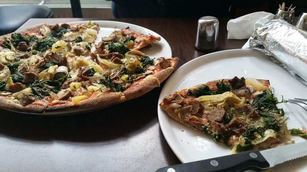 """Photo of Express Pizza  by <a href=""""/members/profile/konlish"""">konlish</a> <br/>Vegan kebab pizza in a whole wheat base with vegan cheese, pineapple, onions, spinach, artichoke and mushrooms. The sliver wrap is a vegan durüm/wrap whole wheat vegan ham lettuce tomatoes pepper and cucumber <br/> April 6, 2015  - <a href='/contact/abuse/image/41789/98066'>Report</a>"""