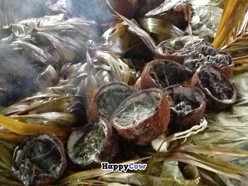 """Photo of Eco Cafe  by <a href=""""/members/profile/Adopt%20A%20Pet"""">Adopt A Pet</a> <br/>Coconuts roasted with taro leaves  <br/> October 8, 2013  - <a href='/contact/abuse/image/42159/56424'>Report</a>"""