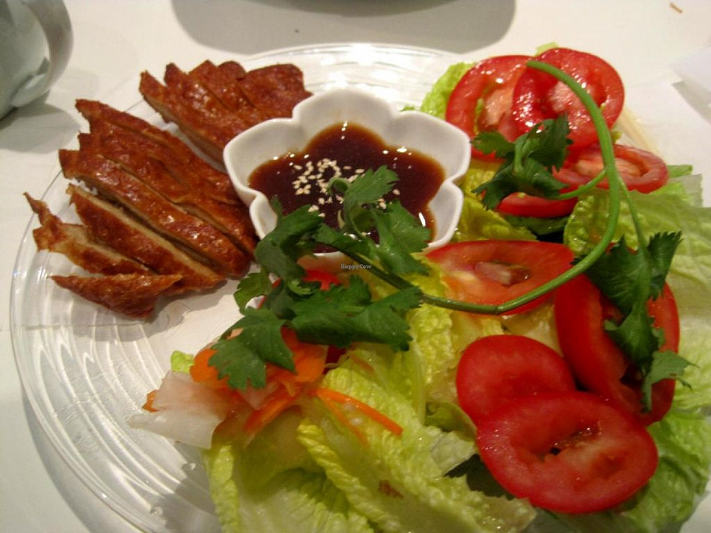 """Photo of CLOSED: Quan Bo De Cuisine Vegetarienne  by <a href=""""/members/profile/Babette"""">Babette</a> <br/>Veggie Crispy Duck. The vegan duck is good, but there is not much else on the plate <br/> July 14, 2015  - <a href='/contact/abuse/image/42200/109248'>Report</a>"""