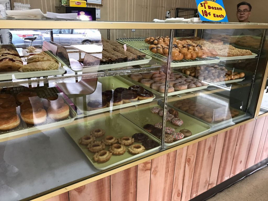 "Photo of Ronald's Donuts  by <a href=""/members/profile/xjamiex"">xjamiex</a> <br/>1 of the 2 cases of donuts. Top 2 rows are vegan.  <br/> November 1, 2016  - <a href='/contact/abuse/image/4228/185848'>Report</a>"