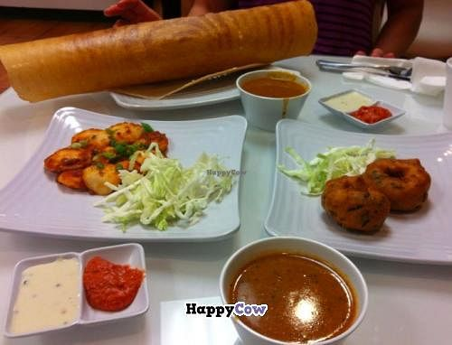 """Photo of CLOSED: dgn Factory - Richmond Ave  by <a href=""""/members/profile/MaryAnneRohrdanz"""">MaryAnneRohrdanz</a> <br/>Clockwise from top: Masala Dosa (vegan), Lentil Soup (vegan), Medu Vada (the circely things, vegan), more Lentil Soup, various vegan chutney, Butter idli (not vegan, eaten by vegetarian pal).   Super fun <br/> October 27, 2013  - <a href='/contact/abuse/image/42457/57418'>Report</a>"""