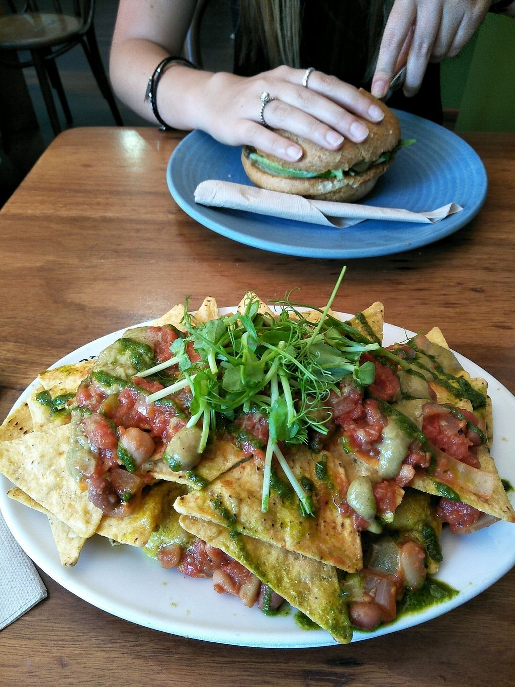 """Photo of Natural Temptation Cafe  by <a href=""""/members/profile/Cynthia1998"""">Cynthia1998</a> <br/>vegan nachos (and vegan burger in background)  <br/> March 10, 2018  - <a href='/contact/abuse/image/42506/368798'>Report</a>"""