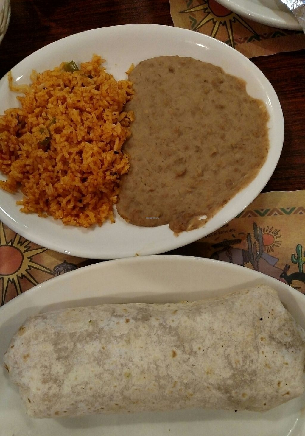 "Photo of La Quesadilla Mexican Grill  by <a href=""/members/profile/RosieTheVegan"">RosieTheVegan</a> <br/>Veggie Burrito with rice and beans.  Vegan options are fabulous!  It is so wonderful to find a Mexican restaurant that doesn't use chicken stock or butter in the rice, doesn't use lard in the beans, and doesn't add milk or milk powder to the guacamole!  They also don't use peanut oil (if that is an allergy concern) <br/> May 19, 2017  - <a href='/contact/abuse/image/42789/260375'>Report</a>"