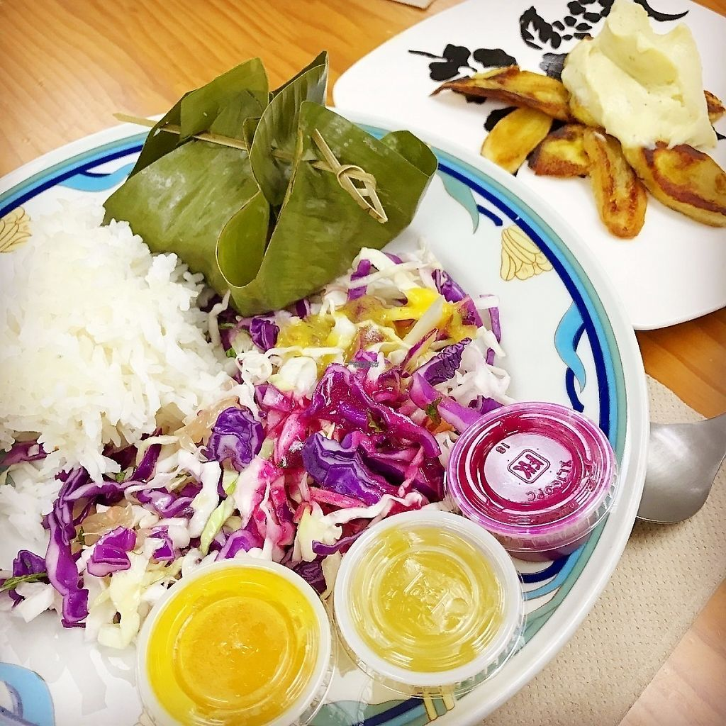 """Photo of Roots Cafe  by <a href=""""/members/profile/lkong"""">lkong</a> <br/>Cambodian amok-style tofu, cabbage salad, dragonfruit dressing, fried plantains with roasted plantain coconut ice cream. All vegan! <br/> December 12, 2016  - <a href='/contact/abuse/image/42790/200175'>Report</a>"""