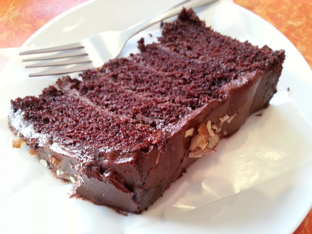 """Photo of CLOSED: Little Phatisserie  by <a href=""""/members/profile/Miggi"""">Miggi</a> <br/>Rich, moist, five-layered vegan chocolate cake. Delicious! <br/> February 22, 2014  - <a href='/contact/abuse/image/43052/64692'>Report</a>"""
