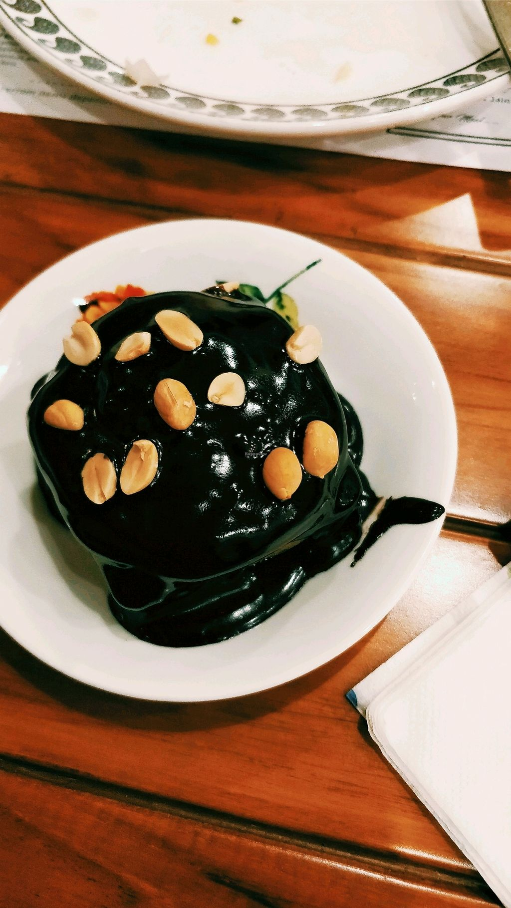 """Photo of The Philosophy Club  by <a href=""""/members/profile/bhupesh100"""">bhupesh100</a> <br/>Banana and peanut cake topped with dark hot chocolate sauce <br/> February 10, 2018  - <a href='/contact/abuse/image/43130/357287'>Report</a>"""