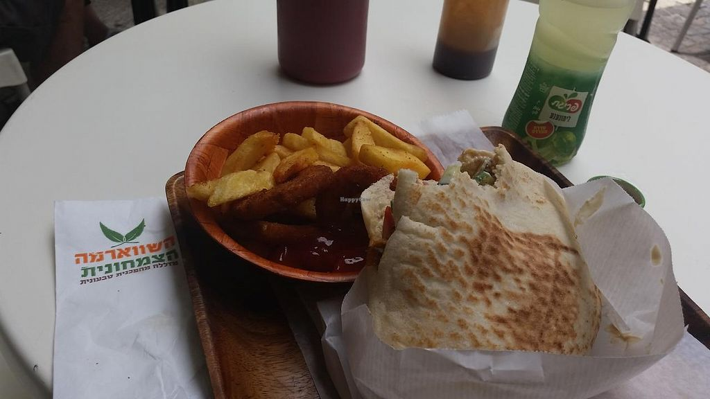 """Photo of The Vegetarian Shawarma  by <a href=""""/members/profile/reuvenk"""">reuvenk</a> <br/>Another delicious lunch at The Vegetarian Shawarma: Shawarma (seitan) in a pita - 18NIS + fries & onion rings and a drink - 16NIS They have lots of condiments available (at least 10) - I took only two <br/> July 2, 2015  - <a href='/contact/abuse/image/43214/107931'>Report</a>"""
