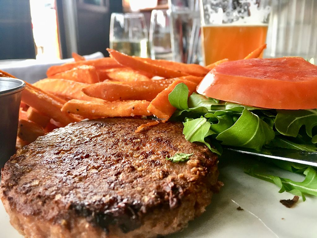 """Photo of The Libertine  by <a href=""""/members/profile/milos99"""">milos99</a> <br/>Beyond Meat burger served on a bed of arugula with sweet potato fries  <br/> February 17, 2018  - <a href='/contact/abuse/image/43261/360434'>Report</a>"""