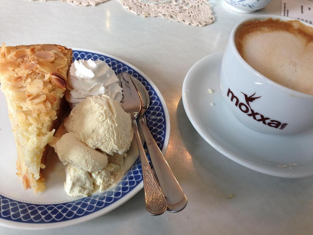 """Photo of Cafe Hibiskus  by <a href=""""/members/profile/Tofuschnecke"""">Tofuschnecke</a> <br/>apple pie with whipped cream and vanilla ice cream (all vegan), plus oat cappuccino <br/> July 29, 2014  - <a href='/contact/abuse/image/43348/75400'>Report</a>"""