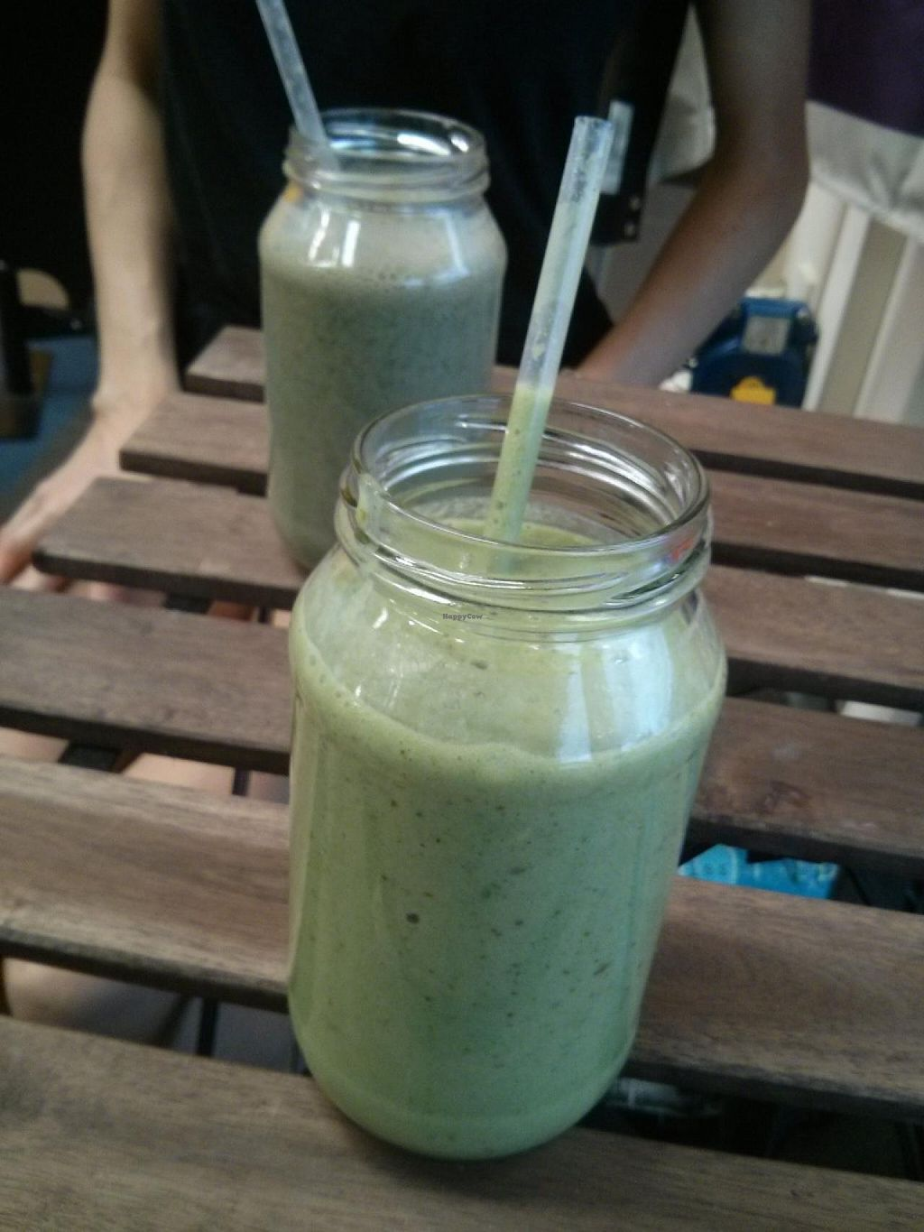 """Photo of CLOSED: 48 Degrees Raw Cafe  by <a href=""""/members/profile/camerongreen"""">camerongreen</a> <br/>Green smoothie, and Superfoods smoothie in the background <br/> January 22, 2014  - <a href='/contact/abuse/image/44078/62948'>Report</a>"""