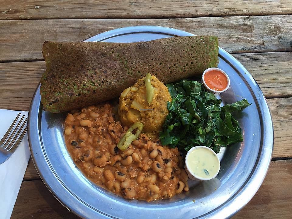 """Photo of The Sudra  by <a href=""""/members/profile/kareninpdx"""">kareninpdx</a> <br/>Kale infused dosa plate: Kale Infused Dosa, Black Eyed Pea Korma, Potato Masala, Collards, Pickled Anaheim Chiles, Cilantro-Lemon Sauce, Roasted Red Pepper-Cashew Chutney <br/> July 9, 2017  - <a href='/contact/abuse/image/44119/278295'>Report</a>"""