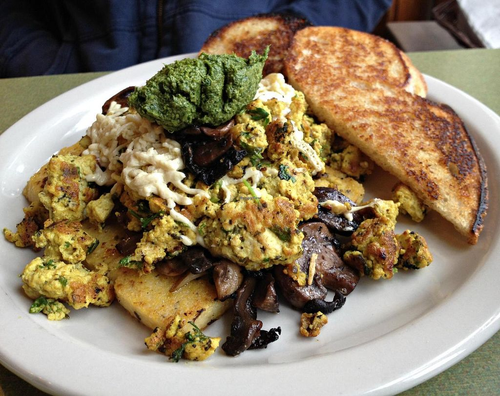Photo of Riverwest Co-op Cafe  by RamblingVegans <br/>Tofu scramble with balsamic porcini mushrooms, Daiya, herbed polenta, and mustard green pesto.   <br/> June 22, 2014  - <a href='/contact/abuse/image/4466/72482'>Report</a>