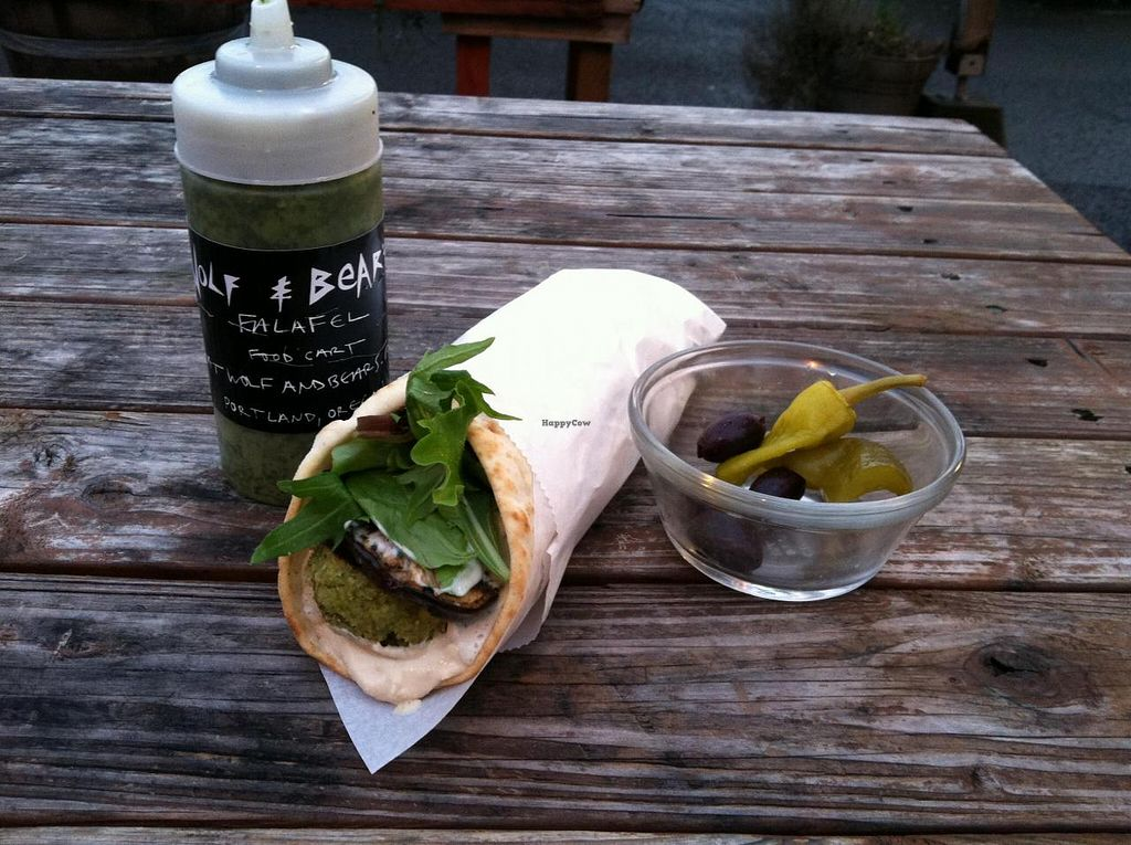 """Photo of Wolf and Bear's Food Cart - SE 28th  by <a href=""""/members/profile/spiffysavannah"""">spiffysavannah</a> <br/>Vegan falafel wrap! <br/> April 29, 2014  - <a href='/contact/abuse/image/44810/68974'>Report</a>"""