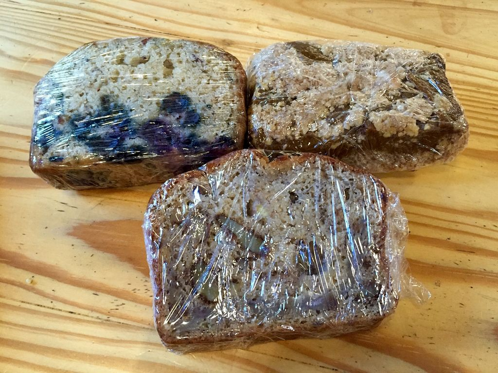 """Photo of The Sentient Bean  by <a href=""""/members/profile/clovely.vegan"""">clovely.vegan</a> <br/>Banana walnut bread, blueberry almond bread, and pumpkin crumble bread.  <br/> October 30, 2015  - <a href='/contact/abuse/image/4486/123267'>Report</a>"""