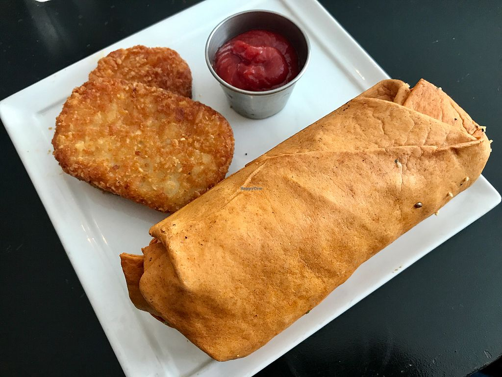 "Photo of Ahimsa Vegan Cafe  by <a href=""/members/profile/FatTonyBMX"">FatTonyBMX</a> <br/>Breakfast burrito. Good, but the pre-made fast food style hashbrown was disappointing.  <br/> August 12, 2017  - <a href='/contact/abuse/image/44909/291821'>Report</a>"