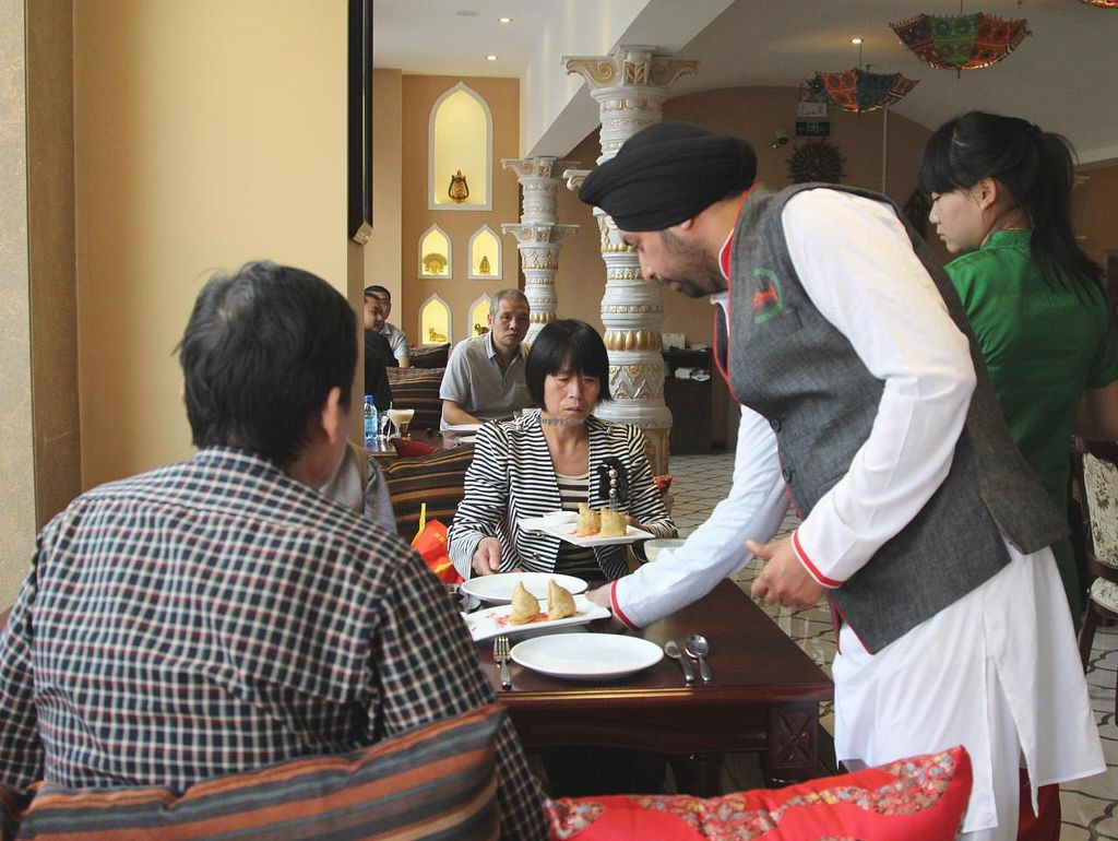 """Photo of Redfort Indian Restaurant  by <a href=""""/members/profile/DevRaturi"""">DevRaturi</a> <br/>staff serving at redfort <br/> August 12, 2014  - <a href='/contact/abuse/image/45317/76793'>Report</a>"""