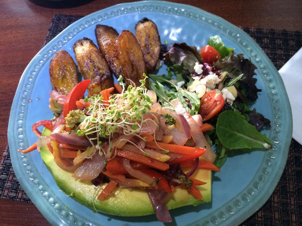"""Photo of Ocean Park Cafe  by <a href=""""/members/profile/Dirtyanddarling"""">Dirtyanddarling</a> <br/>avocado stuffed with grilled veggies with a side of yellow plantain! <br/> March 4, 2015  - <a href='/contact/abuse/image/45729/94872'>Report</a>"""