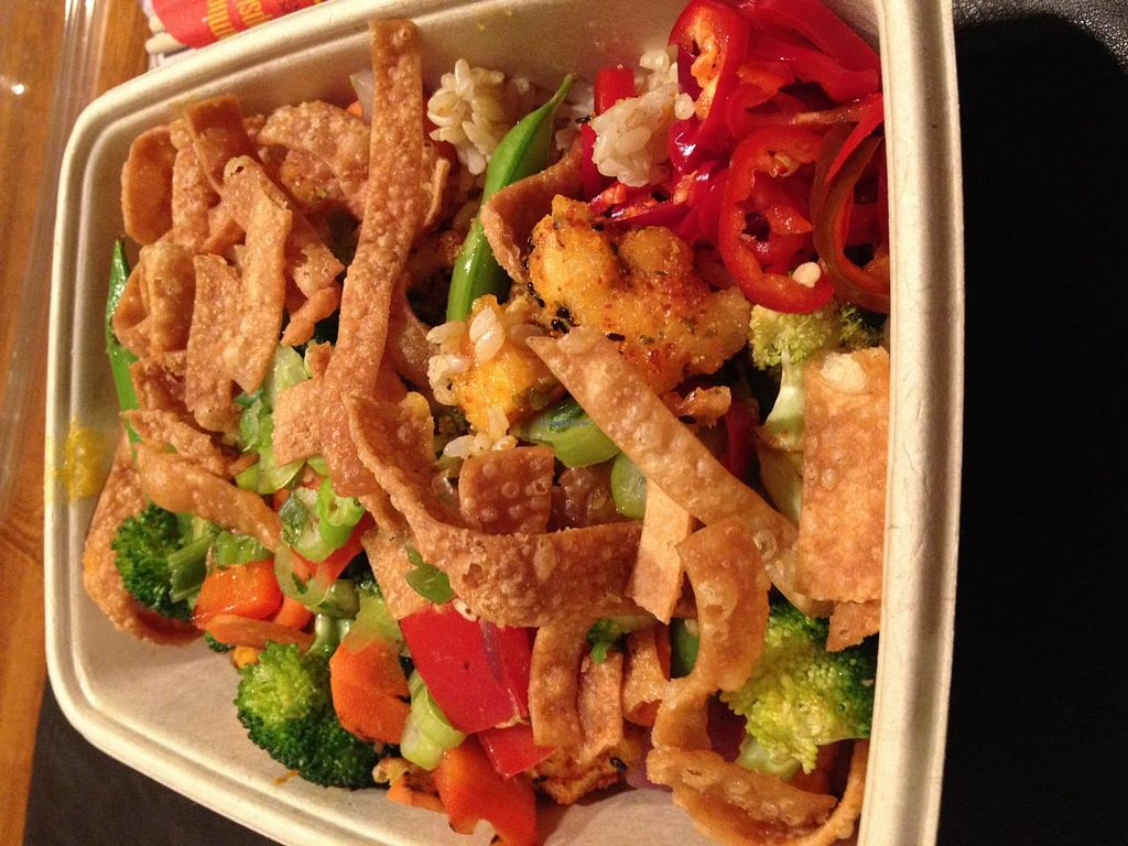 "Photo of Foosia Asia Fresh  by <a href=""/members/profile/Tigra220"">Tigra220</a> <br/>Tofu bowl with brown rice, Holy Foobanero sauce, wok glazed veggies, Fresno Chiles, crispy shallots, and crispy wonton wrappers (The crispy wonton wrappers have been discovered to contain eggs. Do not let the workers tell you otherwise!) <br/> April 15, 2014  - <a href='/contact/abuse/image/46373/67686'>Report</a>"