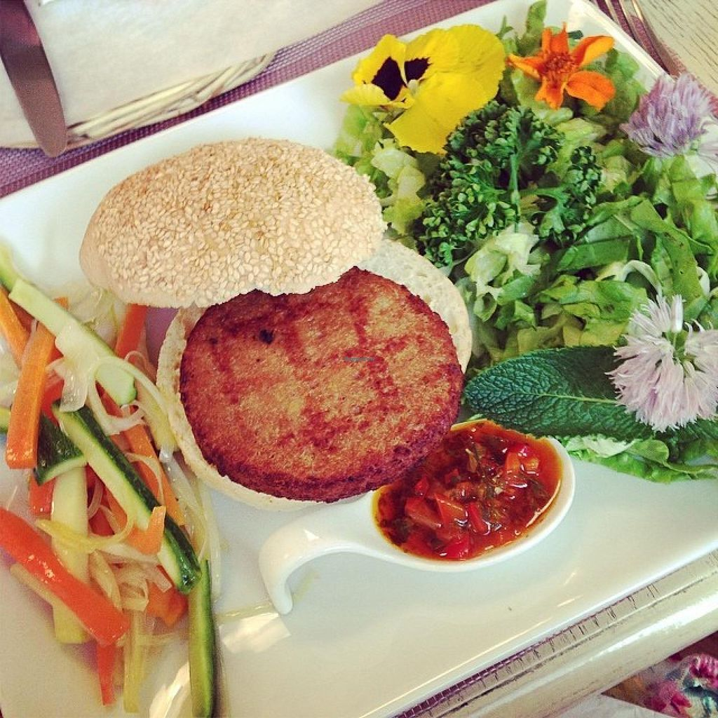 "Photo of Pugi  by <a href=""/members/profile/whatvegetarianseat"">whatvegetarianseat</a> <br/>Tagliere vegano (vegan veggie burger?) with yummy pepper sauce, salad with edible flowers and marinated veggies <br/> September 17, 2014  - <a href='/contact/abuse/image/46567/80256'>Report</a>"