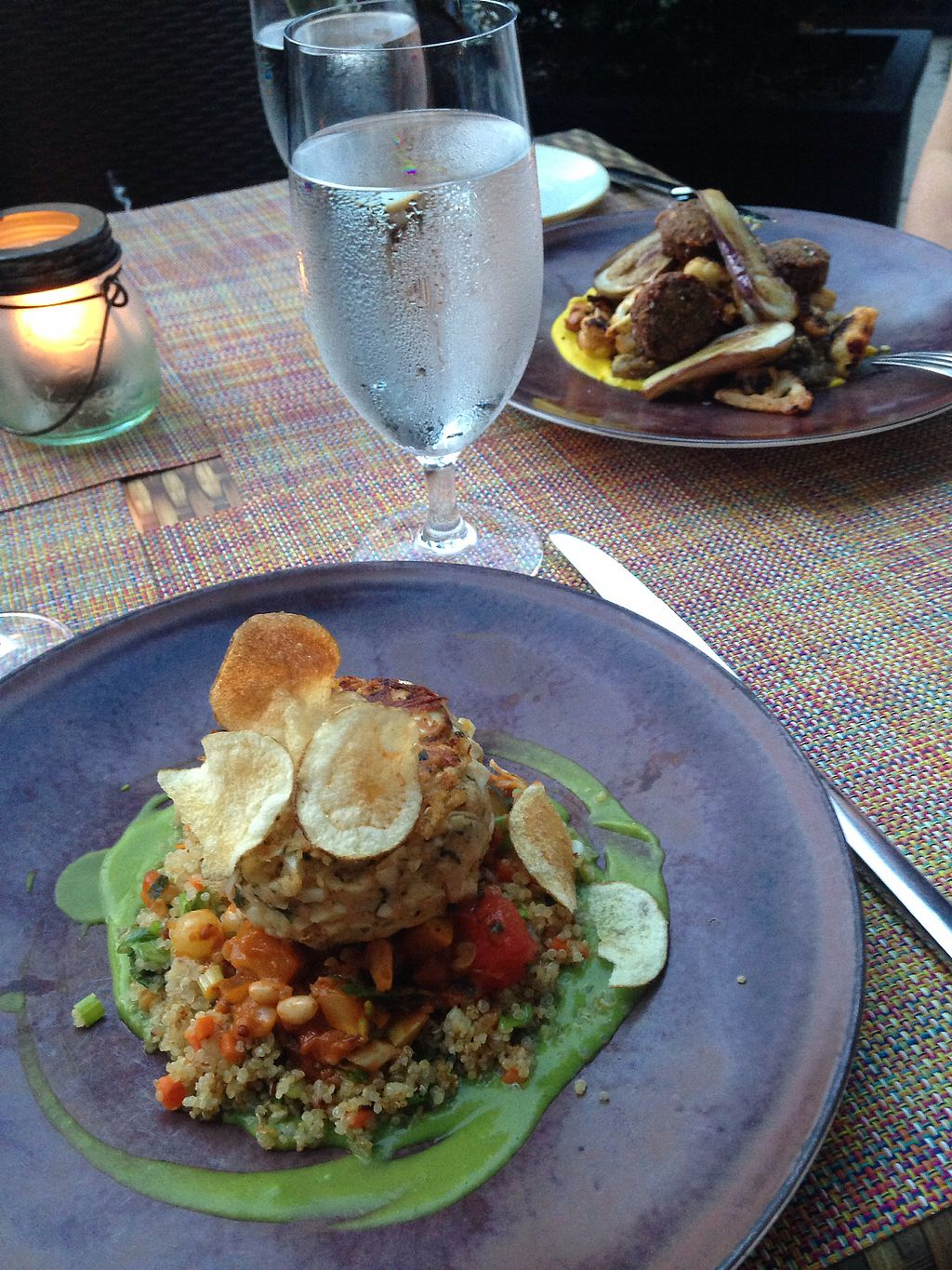 "Photo of Equinox Restaurant  by <a href=""/members/profile/LDR"">LDR</a> <br/>Vegan hearts of palm ""crab cake"" in foreground, eggplant falafel in background <br/> August 6, 2017  - <a href='/contact/abuse/image/46752/289815'>Report</a>"