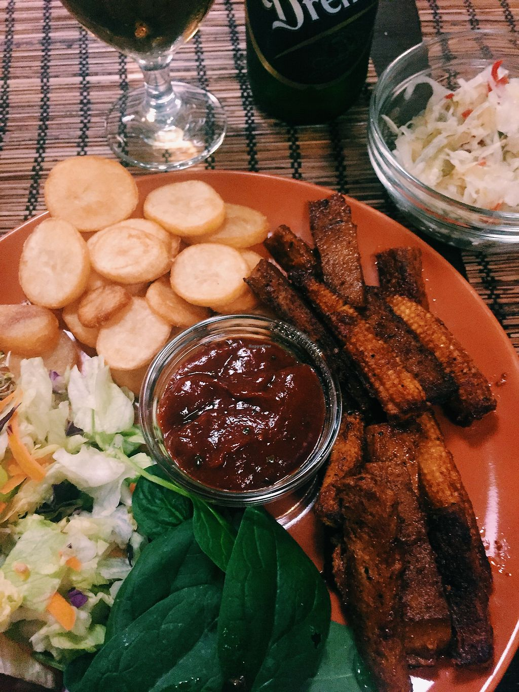 """Photo of Kozmosz Vegan Etterem  by <a href=""""/members/profile/KatjaValentinaKramp"""">KatjaValentinaKramp</a> <br/>BBQ seitan stripes with Hungarian pickles and beer  <br/> January 30, 2018  - <a href='/contact/abuse/image/46900/352813'>Report</a>"""