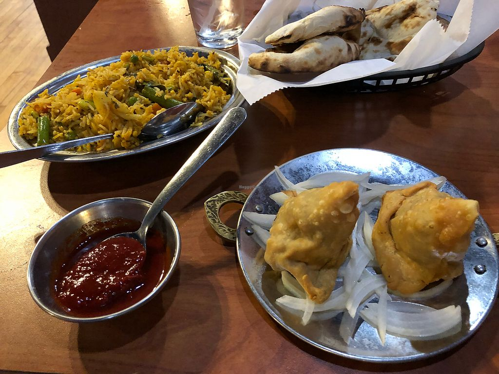 """Photo of Funky Desi  by <a href=""""/members/profile/Jadediana"""">Jadediana</a> <br/>Vegetable Biryani with vegetable samosas. Naan is not vegan.  <br/> April 5, 2018  - <a href='/contact/abuse/image/46908/381236'>Report</a>"""
