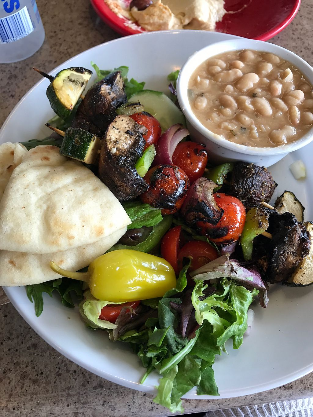 """Photo of Zoe's Kitchen  by <a href=""""/members/profile/KerryElise"""">KerryElise</a> <br/>veggie kabobs with braised white beans and salad <br/> September 1, 2017  - <a href='/contact/abuse/image/47572/299743'>Report</a>"""