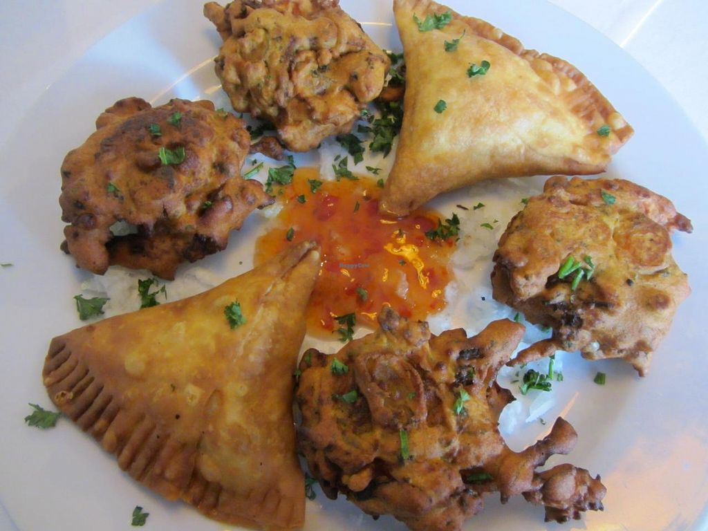"""Photo of Pizzeria-Restaurant Punjab  by <a href=""""/members/profile/VegiAnna"""">VegiAnna</a> <br/>no. 401 Samosa (baked pastry with vegetable filling) and no. 402 Vegetarian Pakora (various vegetables baked in chickpea flour)  <br/> June 20, 2014  - <a href='/contact/abuse/image/48171/72424'>Report</a>"""