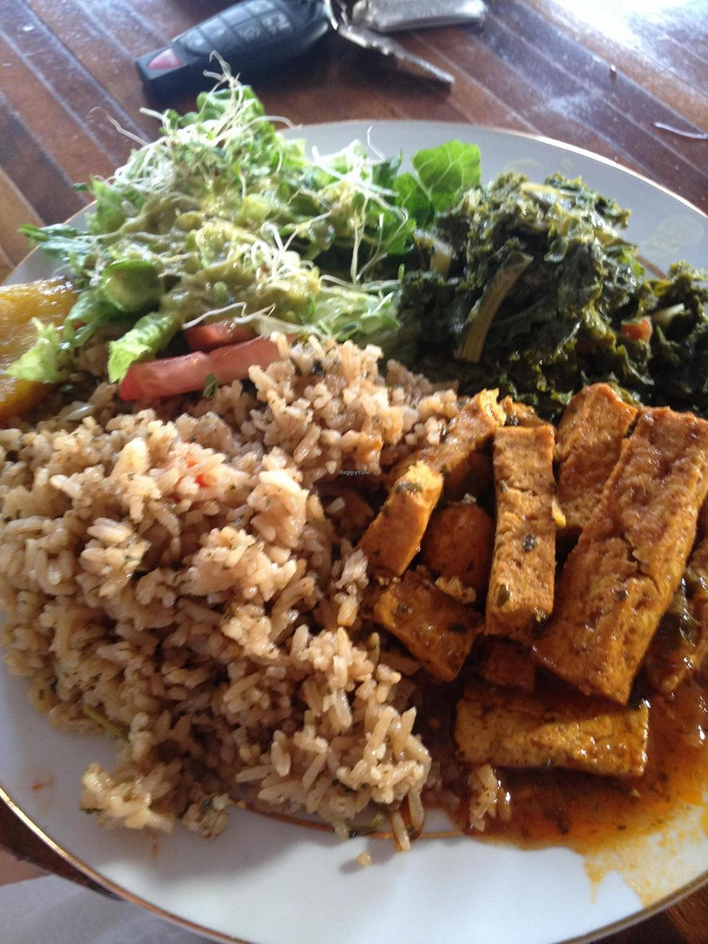 """Photo of Ital in Paradise  by <a href=""""/members/profile/VeggieHeather"""">VeggieHeather</a> <br/>Our meal -- spicy tofu, kale, coconut fried rice, and salad <br/> July 6, 2014  - <a href='/contact/abuse/image/48459/73329'>Report</a>"""