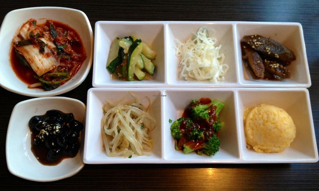 """Photo of Tofu House Korean BBQ  by <a href=""""/members/profile/magicrabbits"""">magicrabbits</a> <br/>These are the side dishes served with meals. Ask for vegetarian or vegan side dishes. They are happy to accommodate you. My 2 absolute favorites are the black beans & the orange potatoes.  <br/> September 28, 2014  - <a href='/contact/abuse/image/48484/81521'>Report</a>"""