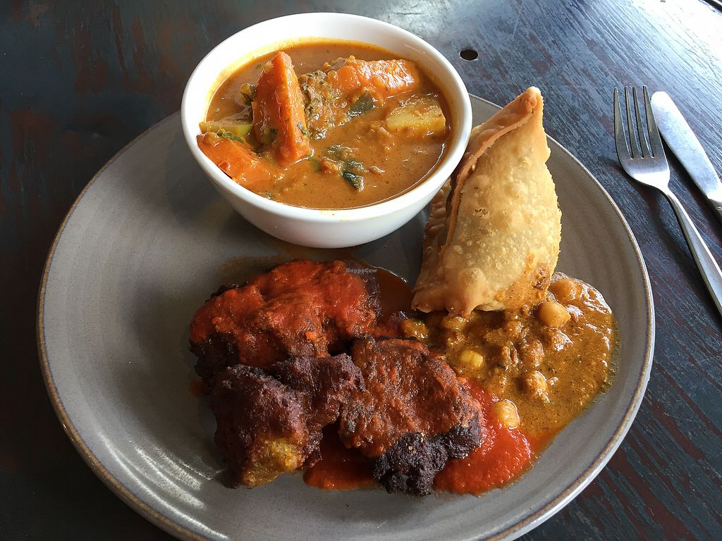 """Photo of Radhey Kitchen and Chai Bar  by <a href=""""/members/profile/Wuji_Luiji"""">Wuji_Luiji</a> <br/>Curry, pakoras and samosa (all vegan) <br/> December 20, 2017  - <a href='/contact/abuse/image/48629/337401'>Report</a>"""